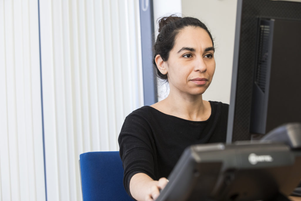Osteopath looking at computer screen